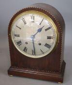 An Edwardian mahogany mantel clock and another
