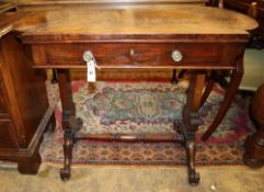 A Victorian Holland and Sons walnut and rosewood side table, Width 92cm