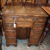 A George I style walnut kneehole desk, width 74cm depth 44cm, height 77cm