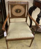 An Edwardian Sheraton revival painted satinwood elbow chair, width 56cm