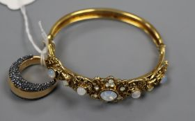 A paste set gilt metal bangle and a similar dress ring.