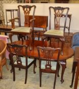 An early 20th century Chippendale revival mahogany dining suite comprising extending dining table