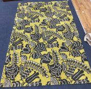 A Designers Guild pale green ground floral rug, 260 x 162cm