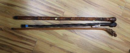 A Japanese Shibayama-style walking cane and two others, longest 90cm