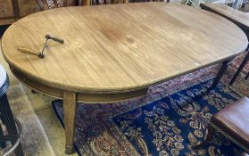A late Victorian mahogany extending dining table with two additional leaves, width 236cm extended (