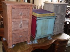A painted three drawer bedside chest, a six drawer chest and a painted stool