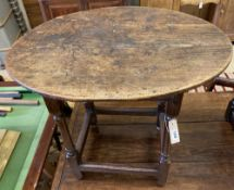An 18th century oak oval centre table, width 72cm, depth 56cm, height 62cm