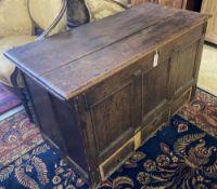 An 18th century panelled oak mule chest, width 118cm, depth 56cm, height 72cm