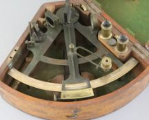 A 19th century bronze and brass sextant with hardwood handle, inscribed 'R.J.Paul Keane R.P.' in