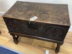 An 18th century oak bible box on associated stand, width 62cm, depth 34cm, height 49cm