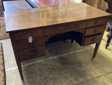 An Edwardian satinwood banded mahogany kneehole dressing table, width 122cm, depth 60cm, height
