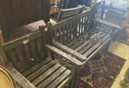 A slatted wood garden bench and two matching chairs, bench 124cm