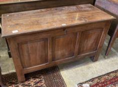 A panelled cedar coffer, width 108cm, depth 46cm, height 64cm