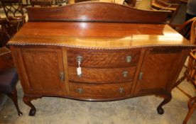 A 1920's Chippendale revival mahogany bow fronted sideboard, W.152cm, D.60cm, H.115cm