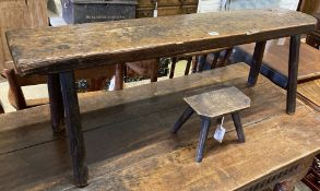A 19th century oak bench and a small beech and elm stool, larger width 114cm, depth 27cm, height