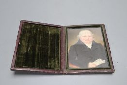 A mid 19th century portrait miniature of a seated gentleman, in folding frame, height 11cm