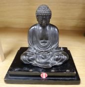 A Japanese Meiji period bronze Buddha, on stepped ebonised plinth, overall height 18cm