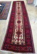 A Belouchi rug, 390 x 96cm