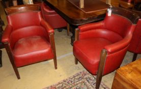 A set of six mahogany framed tub shaped theatre viewing armchairs, with red leatherette