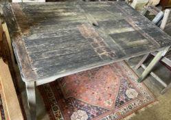 A weathered teak garden table, width 150cm, depth 90cm