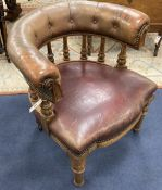 A Victorian walnut tub framed library chair upholstered in faded burgundy leather, width 70cm, depth
