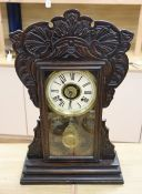 An American dark oak mantel clock, with bell striking movement, height 56cm