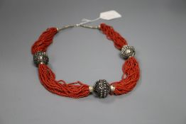 An Eastern white metal and multi strand coral bead necklace, 65cm.