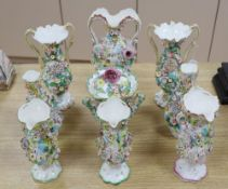 Eight English porcelain floral encrusted vases and a Coalbrookdale type two-handled jar and cover,