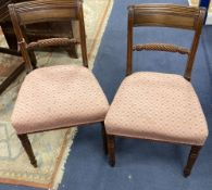 A set of six Regency mahogany dining chairs on turned legs