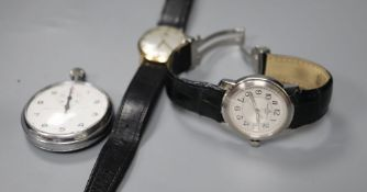 A gentleman's 1970's 9ct gold Tissot watch, a Baume & Mercier steel watch and a Lemania stopwatch.