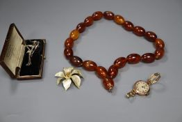 A faux amber bead necklace, a 9ct gold watch and costume jewellery.