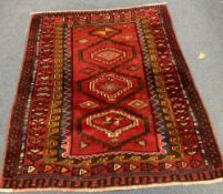 A Caucasian style red ground rug, 204 x 160cm