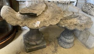 Two reconstituted stone bird baths (one in need of repair), largest diameter 65cm