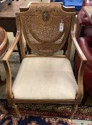 A pair of Edwardian Sheraton revival painted satinwood caned back elbow chairs, width 53cm, height
