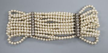 A multi strand simulated pearl and white paste set choker necklace, 32.7cm.