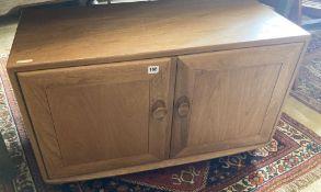 An Ercol light elm cabinet, width 91cm, depth 43cm, height 56cm