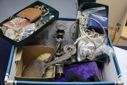 A box of assorted costume jewellery, silver napkin rings, brushes etc.