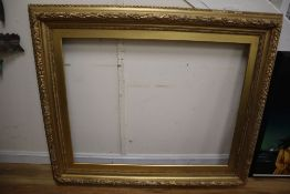 A large 19th century giltwood and gesso picture frame with oak leaf moulding, aperture 85 x 110cm,
