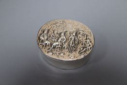 A George III oval silver box and cover, the lid embossed with imbibers, London, 1797, 74mm, 119