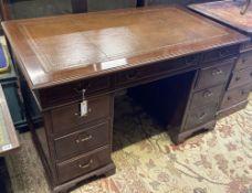 A mahogany pedestal desk fitted brown skiver, width 124cm, depth 70cm, height 75cm