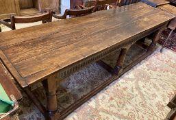 A 17th century style oak refectory table, width 262cm, depth 71cm, height 75cm