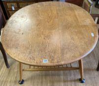 An Ercol light elm and beech oval coffee table, width 99cm, depth 82cm, height 45cm