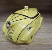 A Sadlers yellow glazed racing car teapot and cover, with silver lustre detail, registration OKT42