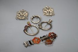 Three Scottish white metal torqs, a silver buckle and a white metal and Scottish hardstone set