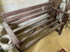 A slatted wood garden bench, width 130cm