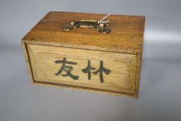 A Mahjong set, oak cased