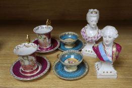 A pair of German porcelain busts of Louis XVI and Marie Antoinette, tallest 16cm, and four cups