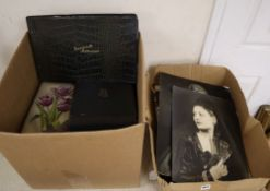 Two boxes of photo albums and loose family photos