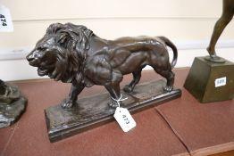 Barye. A bronze lion, width 36cm height 22cm