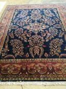 An Indian Tabriz blue carpet, 300 x 250cm